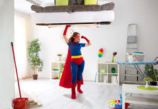 Strong super hero woman holding bad in the air. Cleaning concept royalty free stock image