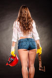 Sexy strong woman feminist with axe and helmet Royalty Free Stock Photos