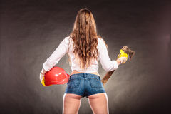 Sexy strong woman feminist with axe and helmet Stock Photography