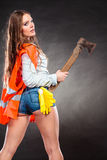 Sexy strong woman feminist with axe at work. Royalty Free Stock Image