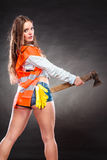 Sexy strong woman feminist with axe at work. Sexy alluring woman wearing helmet and safety workwear holding axe chopper. Strong girl feminist working in man Royalty Free Stock Images