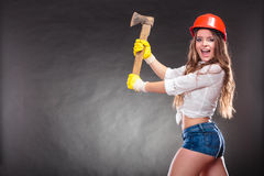 Sexy strong woman feminist with axe working. Royalty Free Stock Images