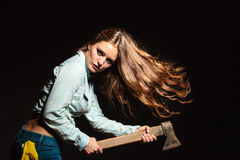 Sexy strong woman feminist with axe working. Royalty Free Stock Image