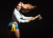 strong woman feminist with axe working. Royalty Free Stock Image