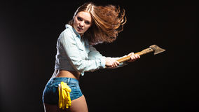 Sexy strong woman feminist with axe working. Royalty Free Stock Photo
