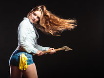 Sexy strong woman feminist with axe working. Stock Image