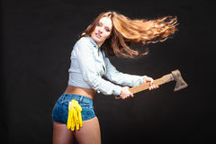 strong woman feminist with axe working. Royalty Free Stock Photo