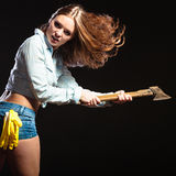 Sexy strong woman feminist with axe working. Stock Photography