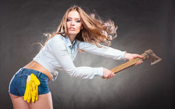 strong woman feminist with axe working. Stock Photos