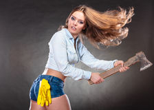 Sexy strong woman feminist with axe working. Sexy seductive woman holding axe chopper. Strong girl feminist working in man profession. Independent female Royalty Free Stock Image
