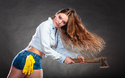 Sexy strong woman feminist with axe working. Royalty Free Stock Photos