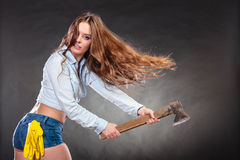 Sexy strong woman feminist with axe working. Stock Images