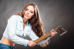 Sexy strong woman feminist with axe working. Sexy seductive woman holding axe chopper. Strong girl feminist working in man profession. Independent female Royalty Free Stock Images