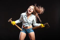 Sexy strong woman feminist with axes working. Royalty Free Stock Image