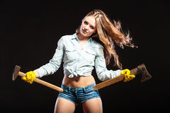 Sexy strong woman feminist with axes working. Royalty Free Stock Photo