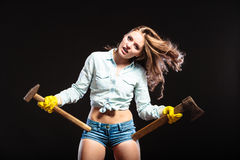 Sexy strong woman feminist with axes working. Stock Photos