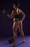 Sexy strong woman working out with weights Stock Image
