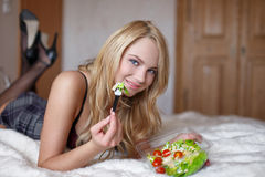 Sexy student in college eating salad Stock Image