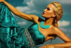 Sexy stylish blond model with bright makeup in evening dress Royalty Free Stock Photography