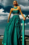 Sexy stylish blond model with bright makeup in evening dress Stock Photography