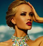 Sexy stylish blond model with bright makeup in evening dress Royalty Free Stock Images