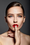 Sexy stylish brunette model with red lips Stock Photo