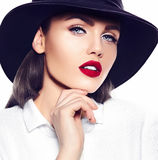 Sexy stylish fashion model in white coat with red lips Royalty Free Stock Images