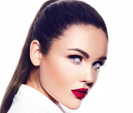 Sexy stylish fashion model in white coat with red lips Stock Image