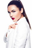 Sexy stylish fashion model in white coat with red lips Stock Photos