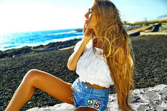 Sexy stylish girl in hipster clothes outdoors Stock Images