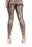 Sexy stylish legs in shimmering golden leggins. Cropped view image of a woman's sexy legs clad in shimmering golden leggins and stilettos Royalty Free Stock Photography