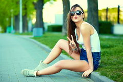 Sexy stylish model in casual summer hipster cloth in the street Stock Photos