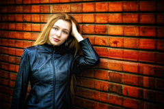 stylish woman in leather near wall royalty free stock images