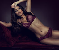Sexy, sultry woman in lingerie Stock Images