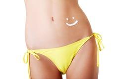 Sexy summeg girl belly with cream Royalty Free Stock Photos