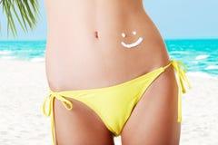 Sexy summeg girl belly with cream Stock Photos