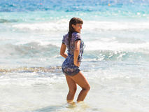 Sexy summer outdoor style beach sea vacation portrait of hot tanned beautiful sporty girl in tunic Stock Image