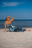 Sexy summer woman on the beach near a sea Royalty Free Stock Images