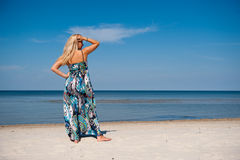 summer woman near sea on the beach Royalty Free Stock Images