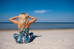 Sexy summer woman near sea on the beach Stock Photography