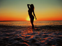 Woman And Sunrise At The Beach royalty free stock images