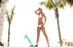 Sexy suntanned lady is ready to go on penny board Stock Photos