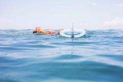 surfer girl with longboard surf. royalty free stock image