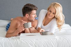 Sexy Sweet Lovers on White Bed Having Drink Royalty Free Stock Photos