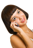 Sexy talking on a cellular phone. Very attractive brunette talking on a cellular phone Stock Photo