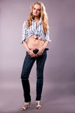 tall pretty young blonde girl in jeans Stock Images