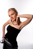 Sexy tall young blonde girl in black dress Stock Image