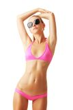 Sexy tan woman in bikini and sunglasses Stock Photos