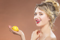 Sexy Tanned Caucasian Woman Posing with Lemon in Hand Stock Images