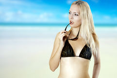 Sexy tanned woman on beach in bikini Royalty Free Stock Photos